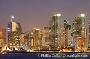 San Diego city skyline at dusk, viewed from Harbor Island, the Star of India at left