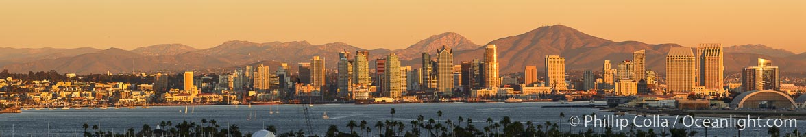 San Diego city skyline, showing the buildings of downtown San Diego rising above San Diego Harbor, viewed from Point Loma at sunset, with mountains of the Cleveland National Forest rising in the distance. A panoramic photograph, composite of seven separate images. San Diego, California, USA, natural history stock photograph, photo id 22257
