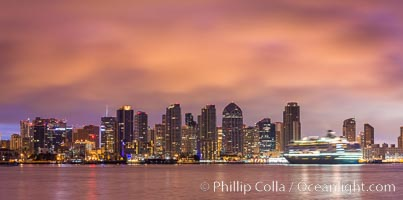 Image 28845, San Diego City Skyline viewed from Harbor Island, storm clouds at sunrise. California, USA, Phillip Colla, all rights reserved worldwide.   Keywords: california:city:clouds:dawn:downtown:morning:san diego:san diego bay:san diego city skyline:storm:sunrise:urban:usa:waterfront.