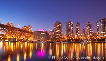 Yaletown section of Vancouver at night, including Granville Island bridge (left), viewed from Granville Island