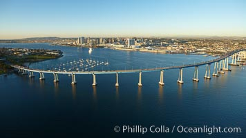 Image 22401, San Diego Coronado Bridge, known locally as the Coronado Bridge, links San Diego with Coronado, California.  The bridge was completed in 1969 and was a toll bridge until 2002.  It is 2.1 miles long and reaches a height of 200 feet above San Diego Bay.  Coronado Island is to the left, and downtown San Diego is to the right in this view looking north. San Diego, California, USA