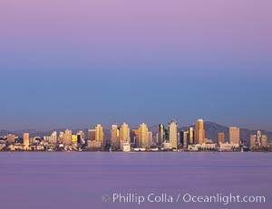 San Diego downtown city skyline and waterfront, sunset reflections and San Diego Bay. Earth-shadow (Belt of Venus) visible in the atmosphere