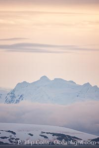 Scenery in Gerlache Strai.  Clouds, mountains, snow, and ocean, at sunset in the Gerlache Strait, Antarctica