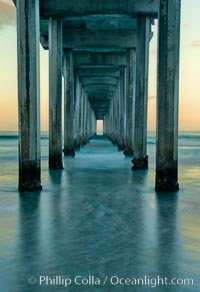 Image 26340, Scripps Pier, predawn abstract study of pier pilings and moving water. Scripps Institution of Oceanography, La Jolla, California, USA, Phillip Colla, all rights reserved worldwide. Keywords: beach, coast, dock, marine, ocean, outdoors, outside, pacific, pier, pier, scene, scenery, scenic, scripps institution of oceanography, scripps pier, sea, sio, water, wave, wharf.