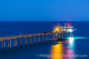 Scripps Institution of Oceanography Research Pier at night, lit with stars in the sky, old La Jolla town in the distance. Scripps Institution of Oceanography, La Jolla, California, USA, natural history stock photograph, photo id 28453