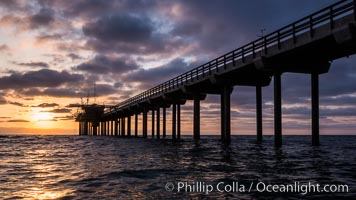 Scripps Pier, Surfer's view from among the waves. Research pier at Scripps Institution of Oceanography SIO, sunset, La Jolla, California