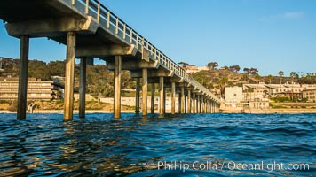 Scripps Pier, Surfer's view from among the waves. Research pier at Scripps Institution of Oceanography SIO, sunset. Scripps Institution of Oceanography, La Jolla, California, USA, natural history stock photograph, photo id 30155