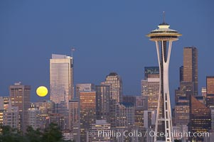 Full moon rises over Seattle city skyline at dusk, Space Needle at right. Seattle, Washington, USA, natural history stock photograph, photo id 13660