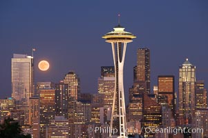 Full moon rises over Seattle city skyline at dusk, Space Needle at right. Seattle, Washington, USA, natural history stock photograph, photo id 13661