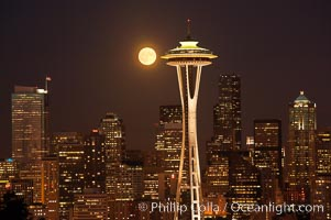 Full moon rises over Seattle city skyline, Space Needle at right