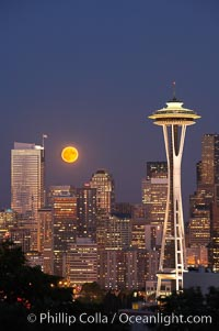 Image 13664, Full moon rises over Seattle city skyline, Space Needle at right. Washington, USA, Phillip Colla, all rights reserved worldwide. Keywords: city, cityscape, downtown, seattle, seattle city skyline, space needle, urban, usa, washington.