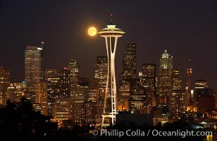 Full moon rises over Seattle city skyline, Space Needle at right. Washington, USA, natural history stock photograph, photo id 13666