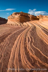 The Second Wave at sunset. The Second Wave, a curiously-shaped sandstone swirl, takes on rich warm tones and dramatic shadowed textures at sunset. Set in the North Coyote Buttes of Arizona and Utah, the Second Wave is characterized by striations revealing layers of sedimentary deposits, a visible historical record depicting eons of submarine geology. North Coyote Buttes, Paria Canyon-Vermilion Cliffs Wilderness, Arizona, USA, natural history stock photograph, photo id 28619
