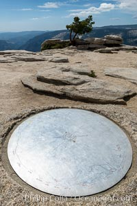 Sentinel Dome summit compass marker, showing notable peaks ion the horizon in all directions, Yosemite National Park
