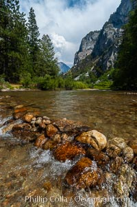The South Fork of the Kings River flows through Kings Canyon National Park, in the southeastern Sierra mountain range. Grand Sentinel, a huge granite monolith, is visible on the right above pine trees. Late summer, Sequoia Kings Canyon National Park, California