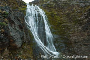 Shackleton Falls, named for explorer Sir Ernest Shackleton, formed from glacial meltwaters, near Stromness Bay. Stromness Harbour, South Georgia Island, natural history stock photograph, photo id 24637