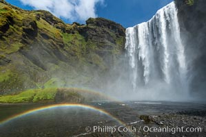 Skogafoss waterfall in Iceland. A double rainbow, full on, all the way. What does it mean?., natural history stock photograph, photo id 35802