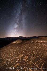 Image 28798, The Milky Way at Night over Sky Rock.  Sky Rock petroglyphs near Bishop, California. Hidden atop an enormous boulder in the Volcanic Tablelands lies Sky Rock, a set of petroglyphs that face the sky. These superb examples of native American petroglyph artwork are thought to be Paiute in origin, but little is known about them. Bishop, California, USA, Phillip Colla, all rights reserved worldwide. Keywords: astrophotography, bishop, california, chalfant, chalfant petroglyphs, evening, hidden location, indian, landscape, landscape astrophotography, milky way, milky way galaxy, native american, night, outdoors, outside, owens valley, paiute, paiute-shoshone, petroglyph, pictograph, scene, scenery, scenic, shoshone, shoshone-paiute, sierra, sierra nevada, sky rock, southwest, stars, volcanic tablelands, wall art.