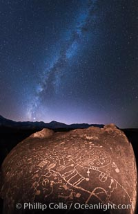 The Milky Way at Night over Sky Rock.  Sky Rock petroglyphs near Bishop, California. Hidden atop an enormous boulder in the Volcanic Tablelands lies Sky Rock, a set of petroglyphs that face the sky. These superb examples of native American petroglyph artwork are thought to be Paiute in origin, but little is known about them. Bishop, California, USA, natural history stock photograph, photo id 28804