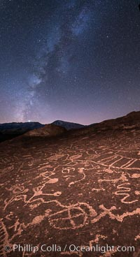 Image 28805, The Milky Way at Night over Sky Rock.  Sky Rock petroglyphs near Bishop, California. Hidden atop an enormous boulder in the Volcanic Tablelands lies Sky Rock, a set of petroglyphs that face the sky. These superb examples of native American petroglyph artwork are thought to be Paiute in origin, but little is known about them. USA, Phillip Colla, all rights reserved worldwide.   Keywords: astrophotography:bishop:california:chalfant:chalfant petroglyphs:evening:hidden location:indian:landscape:landscape astrophotography:milky way:milky way galaxy:native american:night:outdoors:outside:owens valley:paiute:paiute-shoshone:petroglyph:pictograph:scene:scenery:scenic:shoshone:shoshone-paiute:sierra:sierra nevada:sky rock:southwest:stars:volcanic tablelands:wall art.