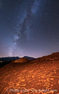 The Milky Way at Night over Sky Rock.  Sky Rock petroglyphs near Bishop, California. Hidden atop an enormous boulder in the Volcanic Tablelands lies Sky Rock, a set of petroglyphs that face the sky. These superb examples of native American petroglyph artwork are thought to be Paiute in origin, but little is known about them. Bishop, California, USA, natural history stock photograph, photo id 28806