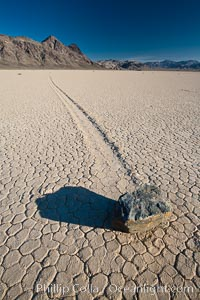 A sliding rock of the Racetrack Playa.  The sliding rocks, or sailing stones, move across the mud flats of the Racetrack Playa, leaving trails behind in the mud.  The explanation for their movement is not known with certainty, but many believe wind pushes the rocks over wet and perhaps icy mud in winter, Death Valley National Park, California