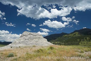 Soda Butte. This travertine (calcium carbonate) mound was formed more than a century ago by a hot spring. Only small amounts of hydrothermal water and hydrogen sulfide gas currently flow from this once more prolific spring, Yellowstone National Park, Wyoming