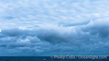 Clouds, weather and light mix in neverending forms over the open ocean of Scotia Sea, in the Southern Ocean., natural history stock photograph, photo id 24762