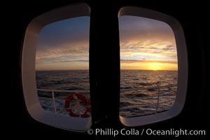 Sunset viewed through the window of my cabin on the M/V Polar Star, somewhere between Falkland Islands and South Georgia Island