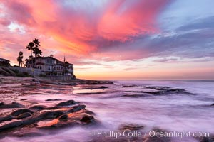 A fiery sunrise explodes over the La Jolla coastline