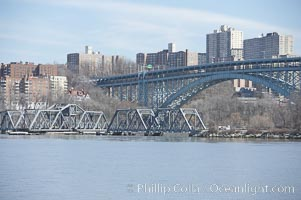 Spuyten Duyvil Swing Bridge (foreground) and Henry Hudson Bridge (background).  The Spuyten Duyvil Bridge is a swing bridge that carries Amtrak's Empire Corridor line across the Spuyten Duyvil Creek between Manhattan and the Bronx, in New York City. The bridge is located at the point where Spuyten Duyvil Creek and the Hudson River meet. Manhattan, New York City, New York, USA, natural history stock photograph, photo id 11150
