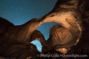 Stars and Iridium Flare over Double Arch, Arches National Park