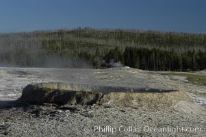 Steam rises from an unidentified geyser, Upper Geyser Basin, Yellowstone National Park, Wyoming