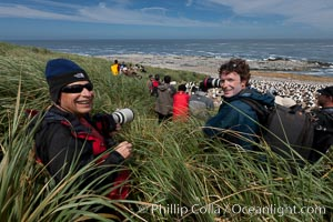 Doug Cheeseman (left), founder of Cheeseman's Ecology Safaris, and professional photographer and guide Patrick Endres (right) enjoy the spectacle of the enormous breeding colony of black-browed albatrosses at Steeple Jason Island, Thalassarche melanophrys