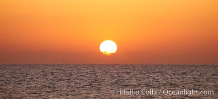 The sun rises over the Pacific Ocean offshore of California. Santa Barbara Island, California, USA, natural history stock photograph, photo id 23559