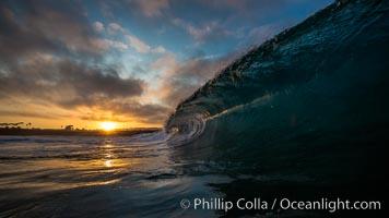 Sunrise breaking wave, dawn surf