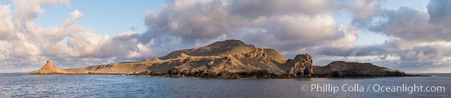 Sunrise at San Clemente Island, south end showing China Hat (Balanced Rock) and Pyramid Head, near Pyramid Cove, storm clouds. Panoramic photo