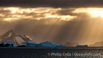 Iceberg, ocean, light and clouds.  Light plays over icebergs and the ocean near Coronation Island. Coronation Island, South Orkney Islands, Southern Ocean, natural history stock photograph, photo id 24796