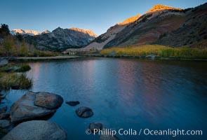 Sunrise on Paiute Peak, reflected in North Lake in the eastern Sierra Nevada, in autumn, Bishop Creek Canyon Sierra Nevada Mountains