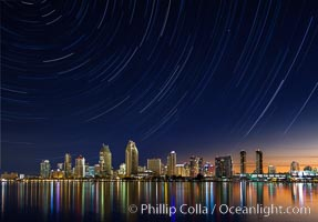 Image 28386, Approaching sunrise and star trails over the San Diego Downtown City Skyline.  In this 60 minute exposure, stars create trails through the night sky over downtown San Diego. San Diego, California, USA, Phillip Colla, all rights reserved worldwide. Keywords: astrophotography, astrophotography landscape, bay, city, downtown, evening, landscape astrophotography, night, nightscape, ocean, san diego, san diego bay, san diego city skyline, sky, skyline, star, star trail, sunrise.
