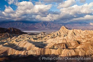 Sunrise at Zabriskie Point, Manly Beacon is lit by the morning sun while clouds from a clearing storm pass by. Zabriskie Point, Death Valley National Park, California, USA, natural history stock photograph, photo id 27656