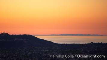 Mount Soledad juxtaposed against a distant San Clemente Island at sunset, San Diego, California