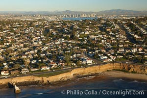 Sunset Cliffs, a coastal community of San Diego, boasts beautiful homes and rugged, scalloped bluffs rising above the Pacific Ocean.  Downtown San Diego can be seen in the distance