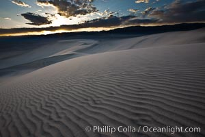 "Sunset on the Eureka Dunes.  The Eureka Valley Sand Dunes are California's tallest sand dunes, and one of the tallest in the United States.  Rising 680' above the floor of the Eureka Valley, the Eureka sand dunes are home to several endangered species, as well as ""singing sand"" that makes strange sounds when it shifts.  Located in the remote northern portion of Death Valley National Park, the Eureka Dunes see very few visitors"