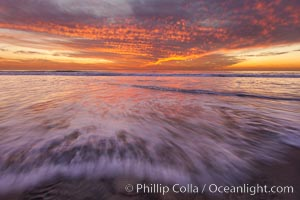 Sunset and incoming surf, gorgeous colors in the sky and on the ocean at dusk, the incoming waves are blurred in this long exposure. Carlsbad, California, USA, natural history stock photograph, photo id 27157