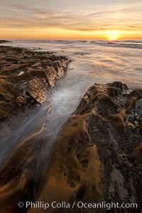 Waves wash over sandstone reef, clouds and sky. La Jolla, California, USA, natural history stock photograph, photo id 26453