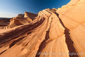 "Sandstone ""fins"", eroded striations that depict how sandstone -- ancient compressed sand -- was laid down in layers over time.  Now exposed, the layer erode at different rates, forming delicate ""fins"" that stretch for long distances. Navajo Tribal Lands, Page, Arizona, USA, natural history stock photograph, photo id 26646"