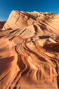 "Sandstone ""fins"", eroded striations that depict how sandstone -- ancient compressed sand -- was laid down in layers over time.  Now exposed, the layer erode at different rates, forming delicate ""fins"" that stretch for long distances. Navajo Tribal Lands, Page, Arizona, USA, natural history stock photograph, photo id 26647"