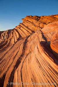 "Sandstone ""fins"", eroded striations that depict how sandstone -- ancient compressed sand -- was laid down in layers over time.  Now exposed, the layer erode at different rates, forming delicate ""fins"" that stretch for long distances, Navajo Tribal Lands, Page, Arizona"