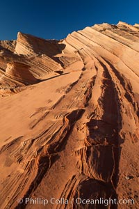 "Sandstone ""fins"", eroded striations that depict how sandstone -- ancient compressed sand -- was laid down in layers over time.  Now exposed, the layer erode at different rates, forming delicate ""fins"" that stretch for long distances. Navajo Tribal Lands, Page, Arizona, USA, natural history stock photograph, photo id 26683"